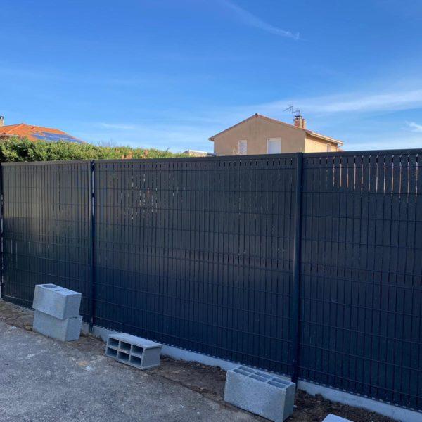 Pose d'une clôture à Lyon